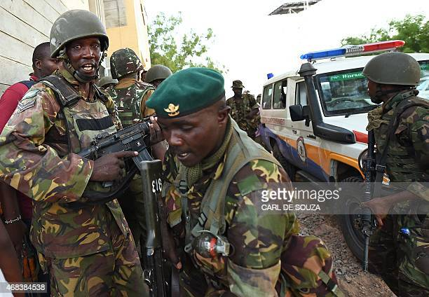 Kenyan Defence Forces are seen at the Garissa University campus after an attack by Somalia's AlQaedalinked Shebab gunmen in Garissa on April 2 2015...
