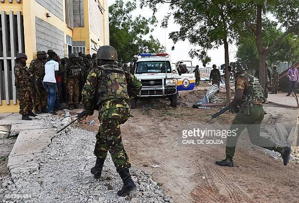 Kenyan Defence Forces run towards the Garissa University campus after an attack by Somalia's AlQaedalinked Shebab gunmen in Garissa on April 2 2015...
