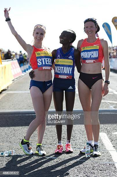 Kenyan distance runner Mary Keitany celebrates winning the Great North Run halfmarathon with second place finisher Britain's Gemma Steel and third...