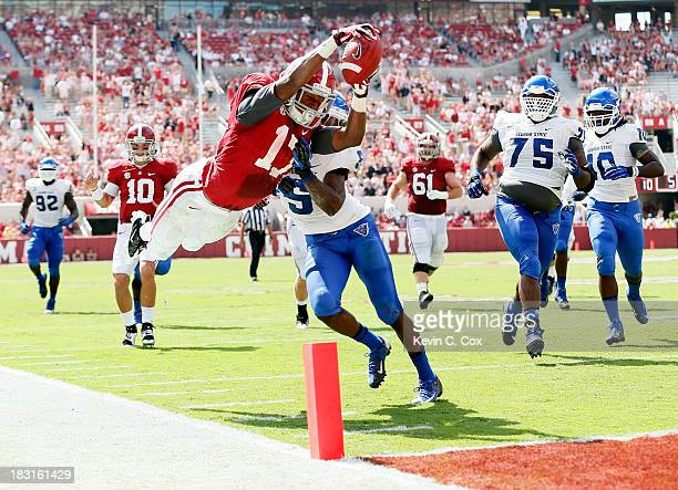 Kenyan Drake of the Alabama Crimson Tide dives for a touchdown against Demarius Matthews of the Georgia State Panthers at Bryant-Denny Stadium on...