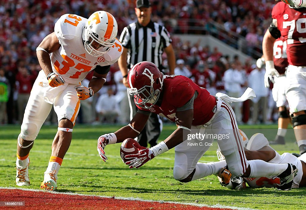 Kenyan Drake #17 of the Alabama Crimson Tide fumbles the ball as he is tackled by Byron Moore #3 of the Tennessee Volunteers at Bryant-Denny Stadium on October 26, 2013 in Tuscaloosa, Alabama.