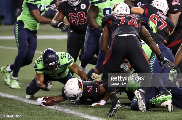 Kenyan Drake of the Arizona Cardinals dives in for a touchdown against the Seattle Seahawks at Lumen Field on November 19, 2020 in Seattle,...