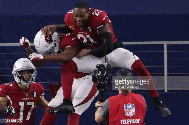 Kenyan Drake of the Arizona Cardinals is congratulated by teammate Patrick Peterson after scoring a touchdown against the Dallas Cowboys during the...