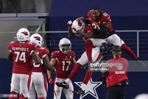 Kenyan Drake of the Arizona Cardinals is congratulated by teammates after scoring a touchdown against the Dallas Cowboys during the fourth quarter at...