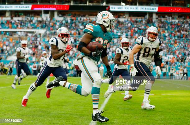 Kenyan Drake of the Miami Dolphins carries the ball for the game winning touchdown during the fourth quarter against the New England Patriots at Hard...
