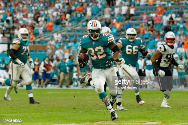 Kenyan Drake of the Miami Dolphins carries the ball for the game winning touchdown defeating the New England Patriots 3433 at Hard Rock Stadium on...