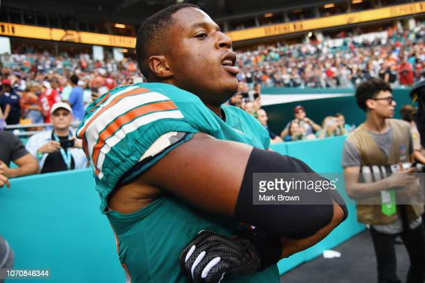 Kenyan Drake of the Miami Dolphins celebrates after defeating the New England Patriots at Hard Rock Stadium on December 9 2018 in Miami Florida