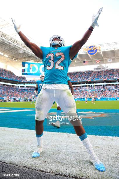 Kenyan Drake of the Miami Dolphins celebrates after scoring a tocuhdown in the third quarter against the Denver Broncos at the Hard Rock Stadium on...