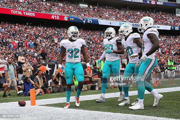 Kenyan Drake of the Miami Dolphins celebrates with teammates after scoring a touchdown during the fourth quarter against the New England Patriots at...