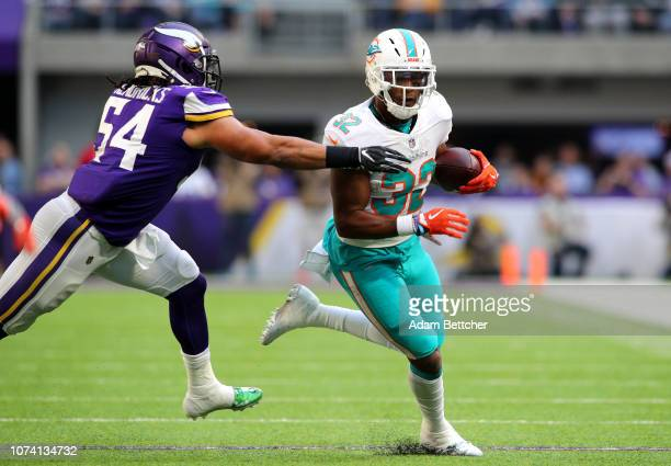 1deedbcab Kenyan Drake of the Miami Dolphins is tackled with the ball by Eric  Kendricks of the