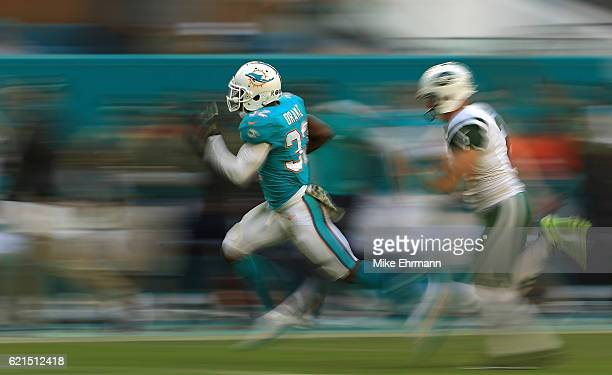 Kenyan Drake of the Miami Dolphins returns a kick for a touchdown during a game against the New York Jets at Hard Rock Stadium on November 6 2016 in...