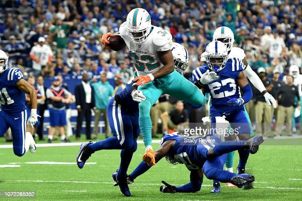 Kenyan Drake of the Miami Dolphins runs for a touchdown in the game against the Indianapolis Colts in the fourth quarter at Lucas Oil Stadium on...