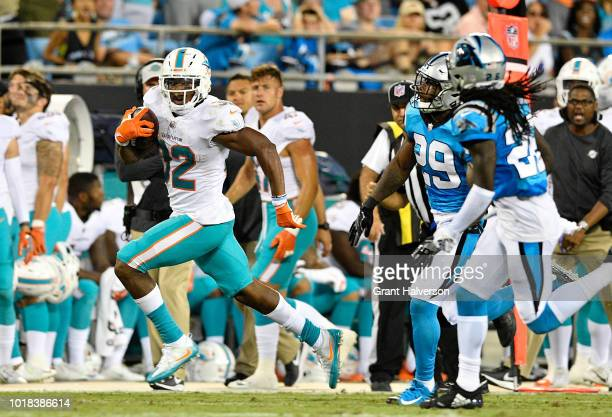 Kenyan Drake of the Miami Dolphins runs the ball against the Carolina Panthers in the first quarter during the game at Bank of America Stadium on...