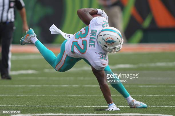 Kenyan Drake of the Miami Dolphins runs the football upfield during the game against the Cincinnati Bengals at Paul Brown Stadium on October 7 2018...