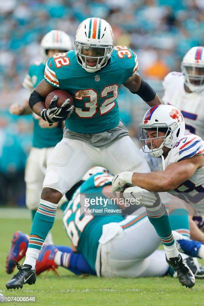 9f9d9acf4 Kenyan Drake of the Miami Dolphins runs with the ball against the Buffalo  Bills at Hard