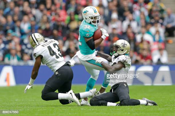 Kenyan Drake of the Miami Dolphins tackled by Ken Crawley of the New Orleans Saints during the NFL game between the Miami Dolphins and the New...