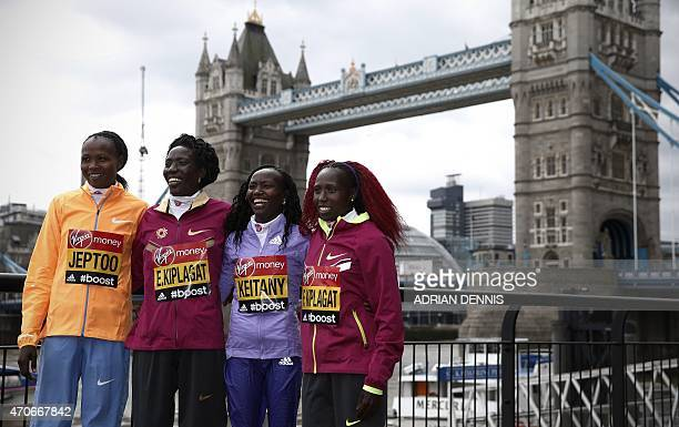 Kenyan elite women runners Priscah Jeptoo , Edna Kiplagat , Mary Keitany and Florence Kiplagat pose for a photograph outside the race headquarters at...