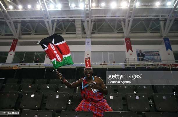 Kenyan fan waves a flag during a basketball match between Turkey and Kenya within the 23rd Summer Deaflympics 2017 at Yasar Dogu Sports Center in...