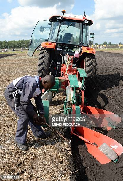 Kenyan farmer Mark Jurui Rongei competes on September 5 2014 in SaintJeand'Illac during the 61st National Ploughing Finals as part of the Les Terres...