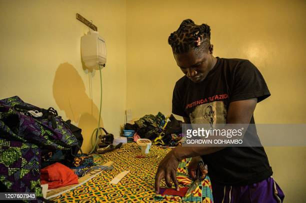 Kenyan fashion desiner of Lookslikeavido David Avido creates masks from remnant of cloth he uses to hand out to people for free so that they can wear...