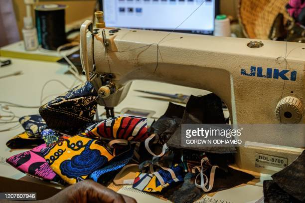 """Kenyan fashion desiner of """"Lookslikeavido"""" David Avido creates masks from remnant of cloth he uses, to hand out to people for free so that they can..."""