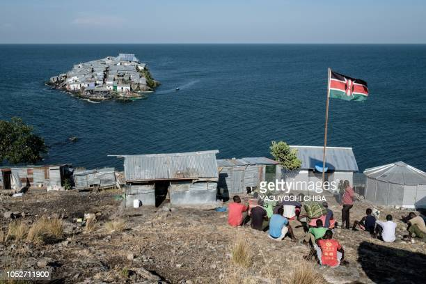 Kenyan flag is seen at the base of Kenyan marine police on October 5 2018 on Usingo island overlooking Migingo island which is densely populated by...