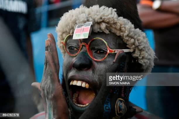 Kenyan football supporter celebrates following a goal against Zanzibar Heroes' during the CECAFA final football match between Kenya's Harambee Stars...