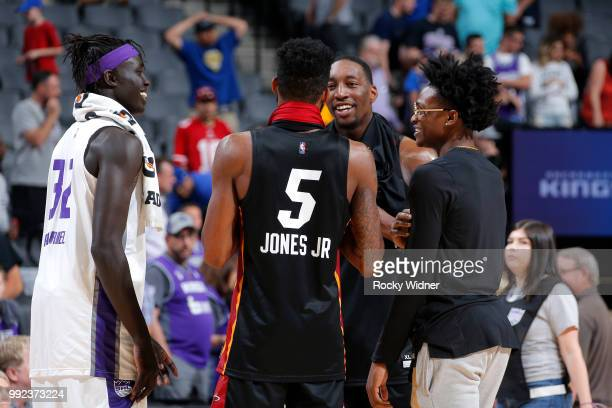 Kenyan Gabriel and De'Aaron Fox of the Sacramento Kings speak with Derrick Jones Jr Bam Adebayo of the Miami Heat during the 2018 Summer League at...