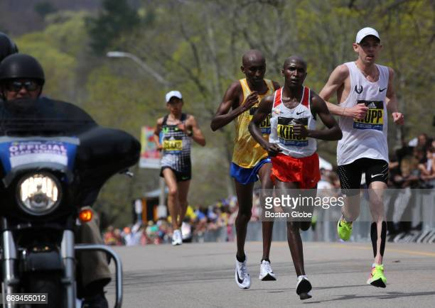 Kenyan Geoffrey Kirui leads the pack up Heartbreak Hill on Commonwealth Avenue in Newton MA during the 121st running of the Boston Marathon on Apr 17...