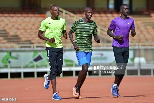 Kenyan hurdlers Olympic silver medallist Boniface Mucheru Kiprono Kosgei and Aaron Koech run during a training session on January 27 2017 in Nairobi...