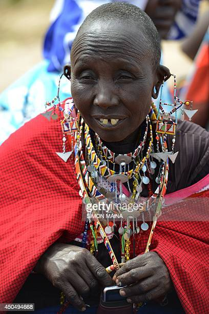 A Kenyan Maasai woman gathers with others during a meeting dedicated to the practice of female genital mutilation in which several participants...