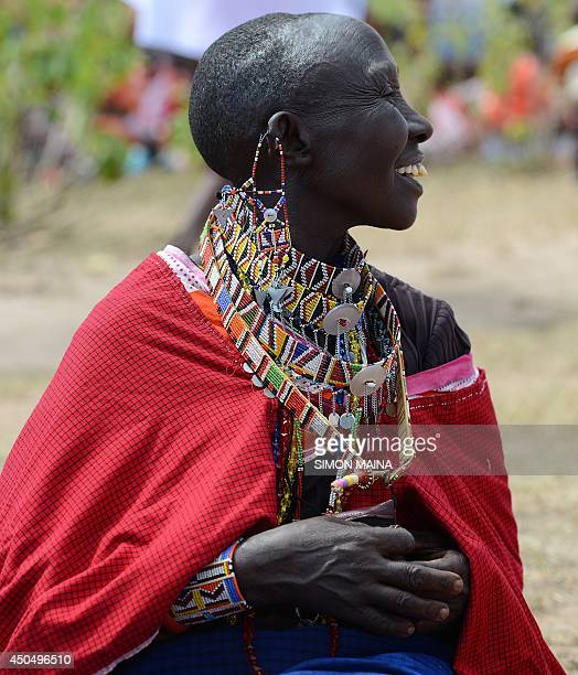 A Kenyan Maasai woman takes part in a gathering and meeting dedicated to the practice of female genital mutilation in which several participants...