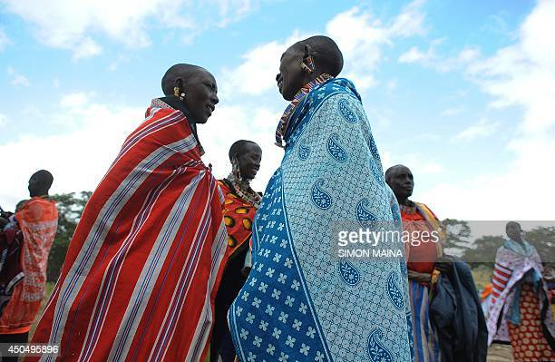 Kenyan Maasai women arrive for a meeting dedicated to the practice of female genital mutilation in which several participants voiced opposition to a...