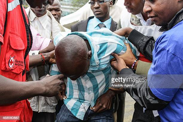 Kenyan man reacts in front of morgue of Chiromo Campus of Nairobi University on April 04 2015 after he identified the corps of his relatives killed...