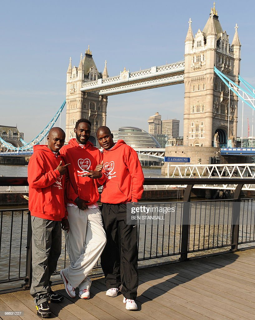 Kenyan marathon runners Samuel Wanjiru, (L) Duncan Kibet (C) and Abel Kirui pose for photographers during a photocall in London, on April 23, 2010. The London Marathon will take place on Sunday April 25.