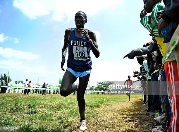 Kenyan Mathew Kisorio [106] runs ahead of compatriot Hosea Macharinyang in the Senior Men's 12 kilometre race on February 19 2011 won by twotime...