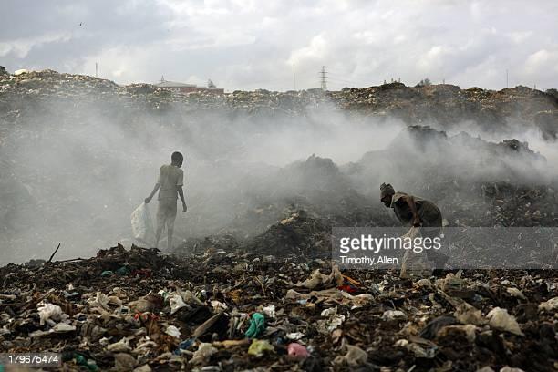 Kenyan men scavenge at Kibarani dump
