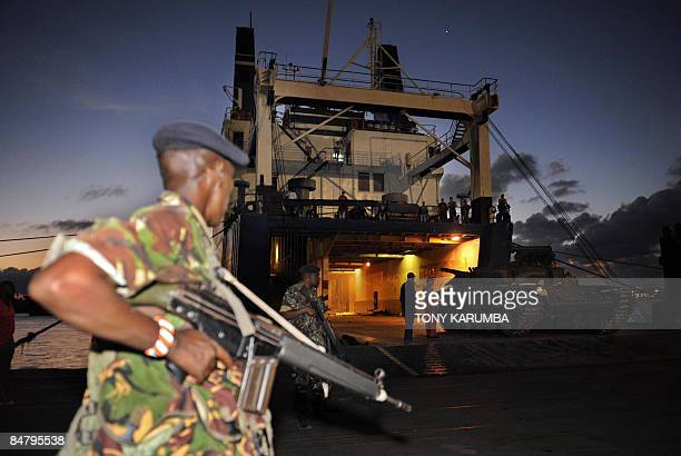A Kenyan military officer keeps guard as Soviet made T72 tanks are offloaded from the MV faina ship at the port of Mombasa on February 14 2009 The...