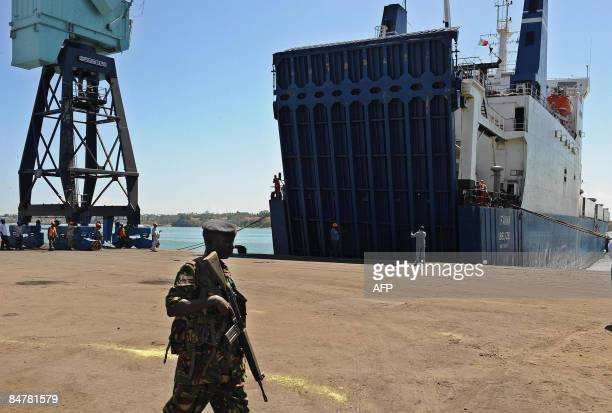 A Kenyan military officer patrols behind the Belize flagged MV Faina on February 13 2009 at the Mombasa harbour where it has been berthed for the...