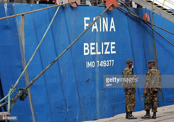 Kenyan military officers stand guard at the Belize flagged MV Faina on February 13 2009 at the Mombasa harbour where it has been berthed for the last...