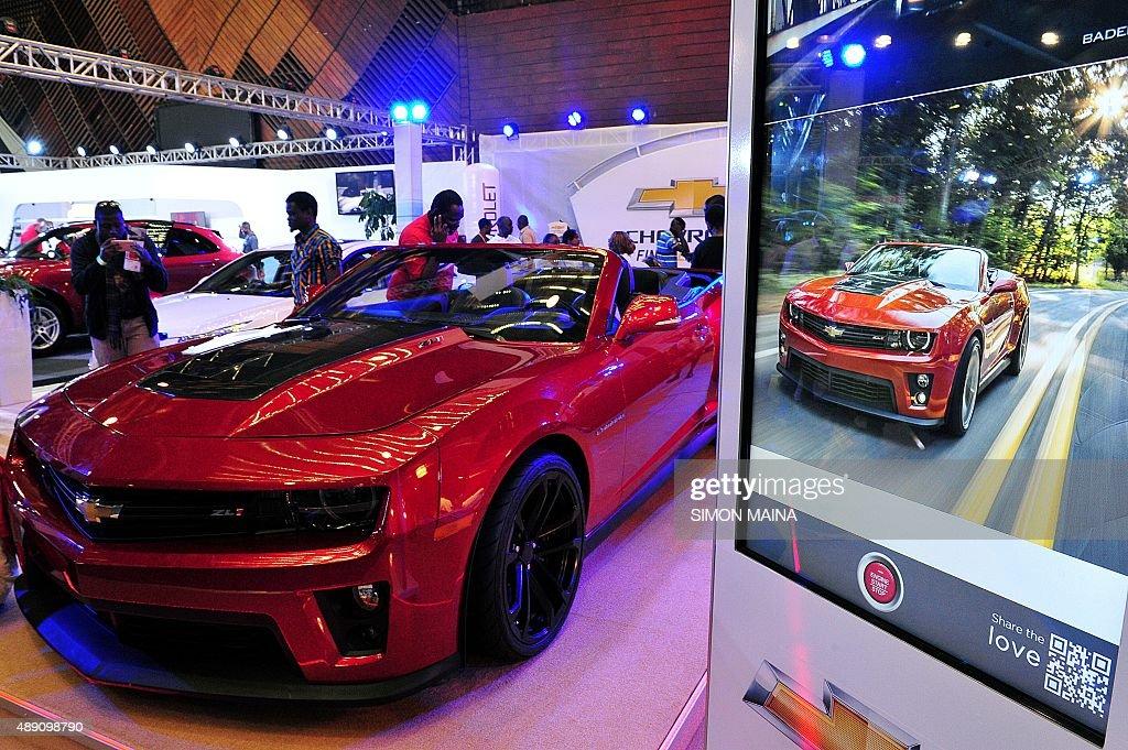 Kenyan Motor Car Enthusiasts Look At Chevrolet Model Camaro During