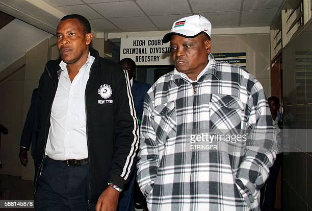 Kenyan Olympics Athletics Manager Michael Rotich walks at Nairobi Court on August 10 2016 where he appears over allegations he demanded bribes to...