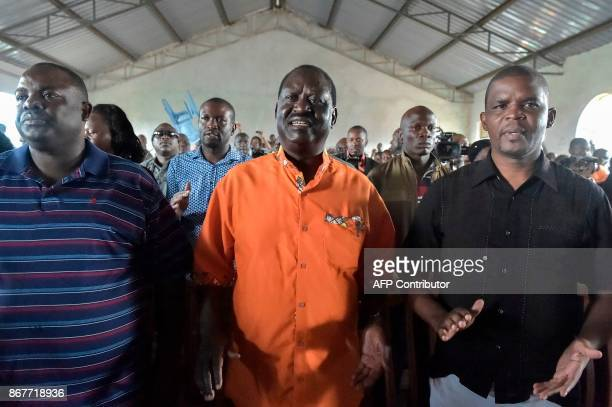 Kenyan opposition leader Raila Odinga takes part at a Sunday's service at the Gatina Church in Kawangware on October 29 2017 Kenya was stuck in limbo...