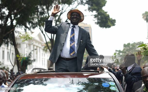 Kenyan opposition leader Raila Odinga waves at supporters as he leaves the Supreme Court in Nairobi on September 1 2017 Kenya's Supreme Court ordered...