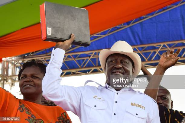 Kenyan opposition party National Super Alliance leader Raila Odinga holds a bible during a rally in Homa Bay on the shores of Lake Victoria on...