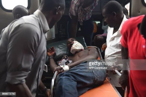 Kenyan paramedics transport Felix Omondi from the ambulance into Jaramogi Oginga Odinga Referral Hospital in Kisumu on October 26 2017 in Kisumu...