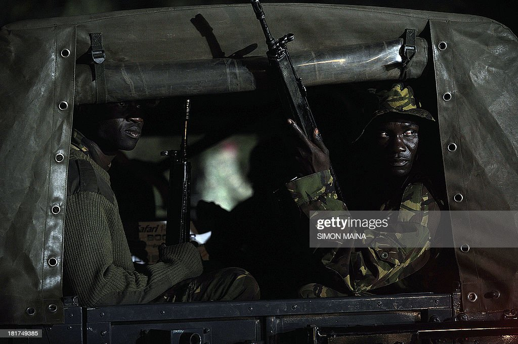 Kenyan paramilitaries drive towards the Westgate mall on September 24, 2013 in Nairobi. Kenyan President Uhuru Kenyatta announced today that the four-day siege by Islamist gunmen of a Nairobi shopping mall was over, with the 'immense' loss of 61 civilians and six members of the security forces.