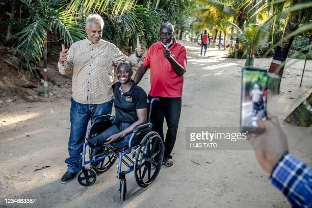 Kenyan para-rower athlete Asiya Mohammed and her main coach Joshua Kendagor take phone pictures with some fans who are wishing her the best for the...