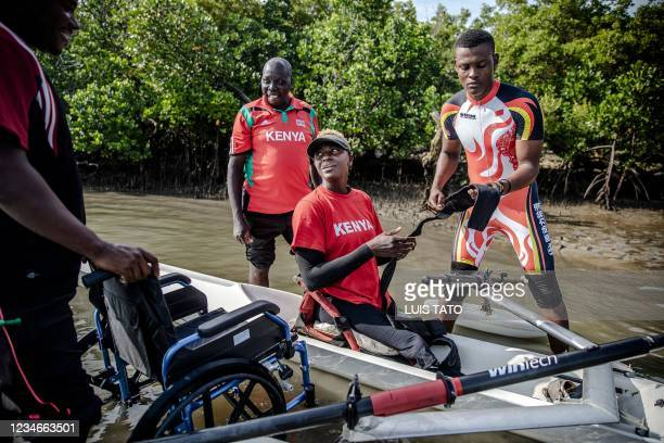 Kenyan para-rower athlete Asiya Mohammed is helped to get into her boat by her coaching staff during her training session at Tudor Water Sports Hotel...