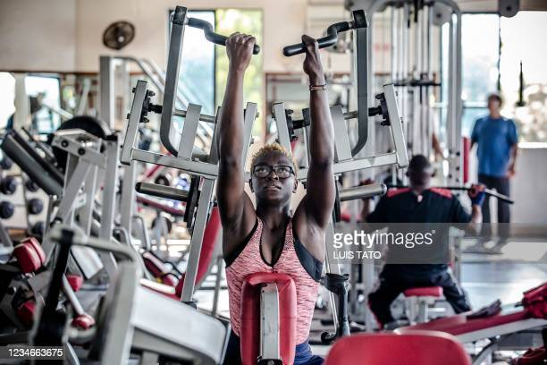 Kenyan para-rower athlete Asiya Mohammed lifts weights during her gym session at Tudor Water Sports Hotel in Mombasa, Kenya on July 26, 2021 ahead of...